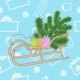 Fir tree and presents on a sled. Fir tree and gifts in a sled on a blue background of the gifts Stock Photo