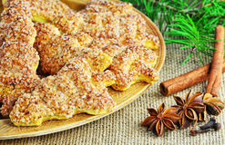 Fir tree shaped cookies for Christmas on plate. Shortcrust biscuits with cinnamon and sugar. Stock Images