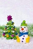 Fir-tree and snowman. Royalty Free Stock Photos