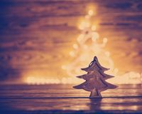 Fir tree toy on wooden background royalty free stock photos