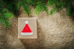 Fir tree twig handmade present box on bagging surface Stock Photo