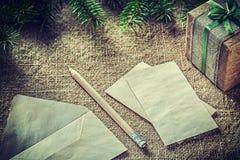 Fir tree twig handmade present box paper pencil on bagging backg Stock Photo
