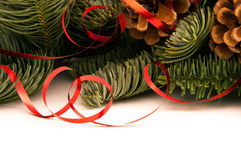 Fir-tree twigs with red ribbons and cones Stock Image