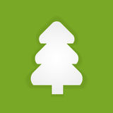 The fir-tree which is cut out from white paper on a green backgr Royalty Free Stock Images