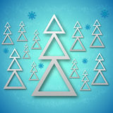 Fir trees background. A vector illustration of fir trees with shadows and snowflakes on an icy background Stock Photos