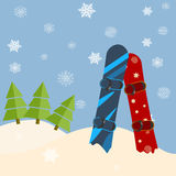 Fir trees, snowboards, hills. Winter bright day, blue sky, snow. Falling Royalty Free Stock Images