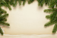 Fir twigs on wooden table with paper sheet Stock Image