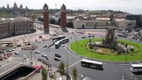 Fira de Barcelona Square Life Traffic Time Lapse. Vehicles and pedestrians in the Plaza Spain in Fira de Barcelona stock video footage