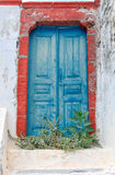 Fira. Entrance to the abandoned house. Stock Photo