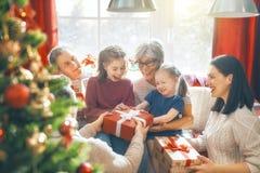 Fira jul för familj royaltyfri fotografi