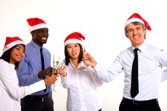 Fira jul för Multi-ethnic lag royaltyfri fotografi