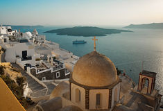 Fira panorama at sunset in Fira, Santorini, Greece. Fira panorama and church cupolas at sunset in Fira, Santorini, Greece Stock Photo