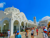 Fira, Santorini, Greece - June 10, 2015: People resting on Promenade of Fira at Santorini Greece and enjoying the view Royalty Free Stock Images