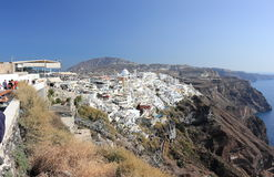 Fira, Santorini, Greece - September 17, 2016: Tourists travel to the picturesque village Fria on Santorini Island, Greece. Royalty Free Stock Image