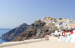 Fira, Santorini, Greece - September 17, 2016: Tourists travel to the picturesque village Fria on Santorini Island, Greece. Royalty Free Stock Images