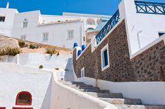 Fira street with whitewashed and blue houses on the island of Thira (Santorini), Greece. Stock Images