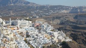 Fira town located on volcanic islands, travel to Santorini, aerial panorama. Stock footage stock footage
