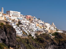 Fira Town in Santorini, Greece. The white buildings of Fira town, clinging to the steep cliffs of the volcanic caldera. Santorini, Greece Stock Image