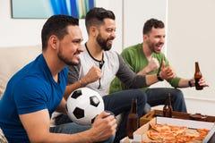 Fira vår fotbolllags seger royaltyfri foto