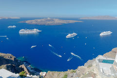 Fira. View of the old harbor. Passenger ships in the old port of Fira early sunny morning. Santorini. Greece stock images