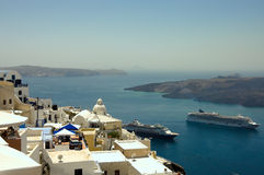 Fira village roofs and boats Royalty Free Stock Images