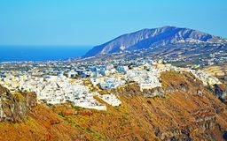 Fira village Santorini island skyline Cyclades Greece. View of picturesque Santorini island with Fira town traditional cycladic cubist homes cling precariously Stock Photo