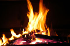 Fire 03. A log fire burning, with a few embers at the bottom Royalty Free Stock Image