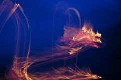 Fire. Burning flame on a dark blue background stock illustration