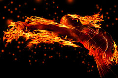 Fire. Abstract fire girl over black background Royalty Free Stock Image