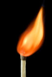 On fire. Match on fire against black background Stock Photos