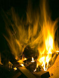 Fire. Sparks fly, wood burns, smoke rises Stock Image
