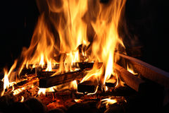 Fire. A massive stack of hot red and yellow flames with flying embers stock photos