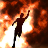 On fire. Editable  silhouette of a running man with raised arm and fiery smoke behind with background made using a gradient mesh Royalty Free Stock Images