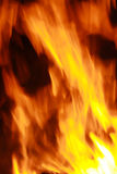 Fire. Flames raising in a dark background royalty free stock image