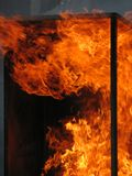Fire. Breaking out of a metal window frame royalty free stock images
