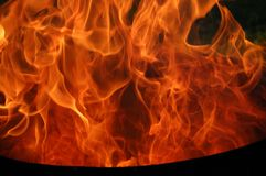 Fire. Flames on black background royalty free stock photos