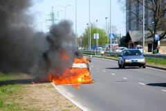 Fire. Of the car on a city road Royalty Free Stock Photos