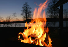 Fire. And river at late evening Stock Image