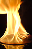 Fire. Burning CD on Fire with Dark Background Royalty Free Stock Photo
