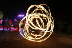 Fire. Performer in a rave party outdoors Royalty Free Stock Images