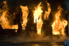 Fire. Apartment building on Fire at Night time Stock Photo