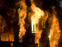 Fire. Apartment building on Fire at Night time Stock Photos