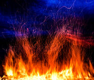 Fire. Photo on a dark blue background Royalty Free Stock Images