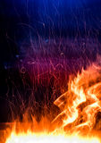 Fire. Photo on a dark blue background Royalty Free Stock Photo