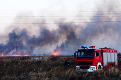 Fire. A fire happened in a wide plant field in DongYing,China at about 16:00 in the last day of 2007, Beijing time.The car in this pic is a fire engine royalty free stock image