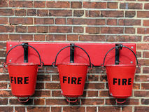 Fire!. Old fire buckets at a train station stock photography