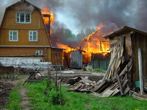 Fire. Burns a country house Royalty Free Stock Images