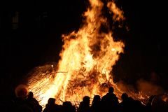 Fire. People are standing front of huge fire Stock Photo