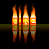 Fire. The word fire catching fire on black background Royalty Free Stock Image