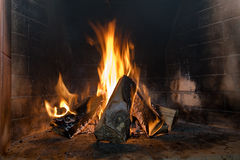 Fire. Wood blaze in heater. Brick wall Stock Images